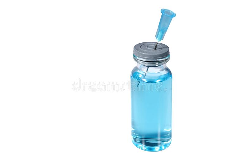 A vial with light blue vaccine and injection needle. Isolated on white background stock image