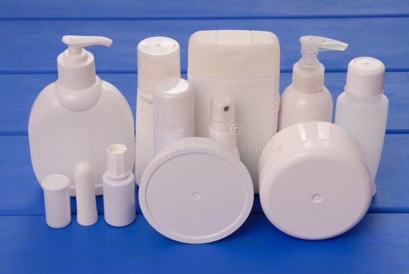 Vials of cosmetics, cosmetic bottles, assortment of cosmetic fla stock image
