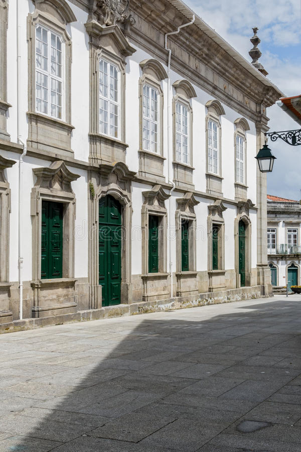 Viana do Castelo, Portugal. A street with white-painted buildings and traditional lamp in the old quarter of Viana do Castelo, Portugal royalty free stock images