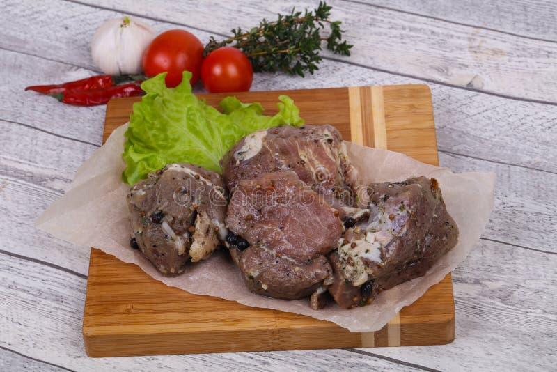 Viande de porc marinée prête pour coocking image stock