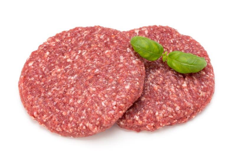 Viande fraîche crue d'hamburger d'isolement sur le blanc photographie stock
