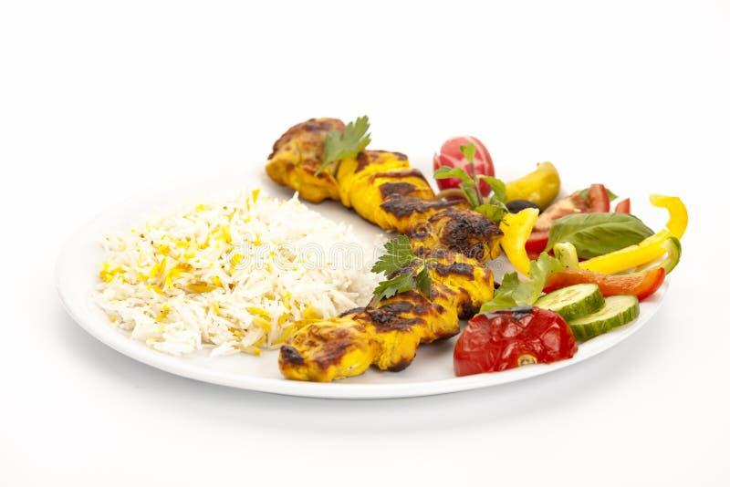 Viande grillée de poulet avec du riz, les herbes et la salade images stock