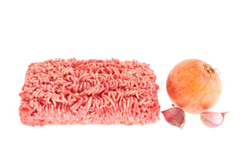Viande hachée, oignon et ail. images libres de droits