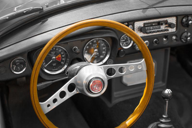 Vianden, Luxembourg; 08/12/2018: view of the steering wheel and speedometer in the interior of a MG MGB, a vintage old classic. Sport car royalty free stock images
