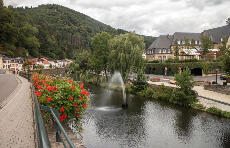 Vianden and Our river. Old Vianden town in Luxembourg cityscape with Our river stock photo