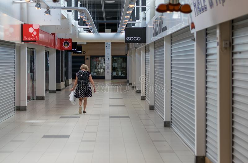 VIBORG, DENMARK - AUGUST 14, 2016: An unidentified woman walkin. G on in a closed mall in Viborg, Denmark royalty free stock image