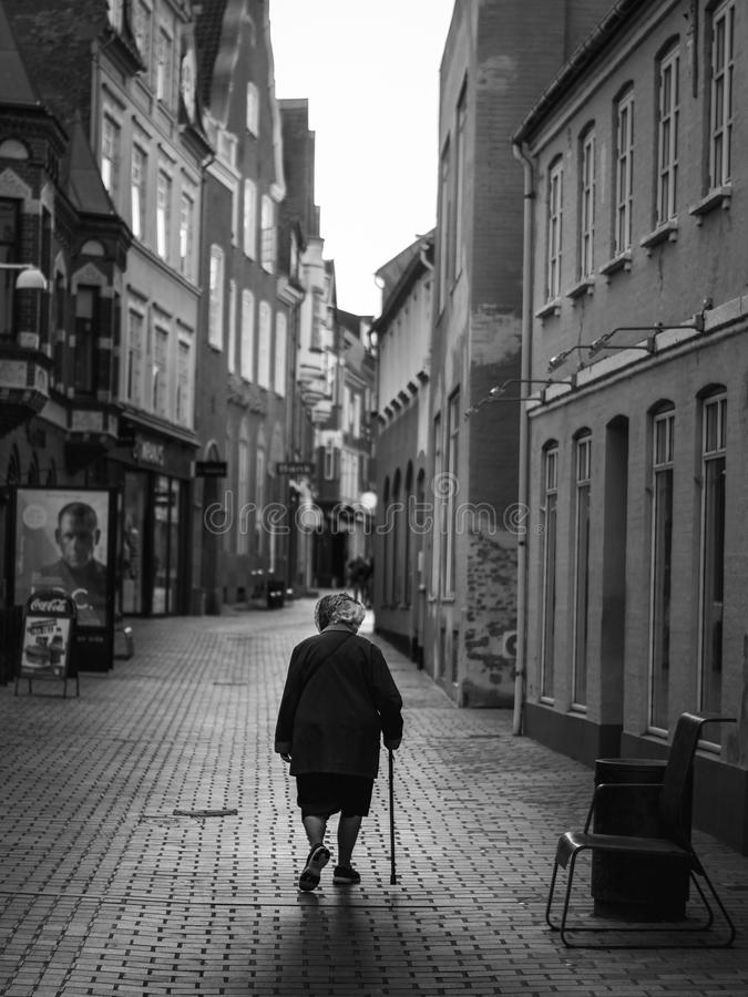 VIBORG, DENMARK - AUGUST 09, 2016: An unidentified woman walking in Viborg royalty free stock images