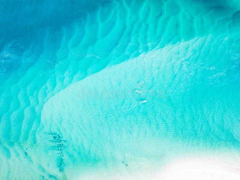 A vibrant aerial view of the beach with blue water stock photos