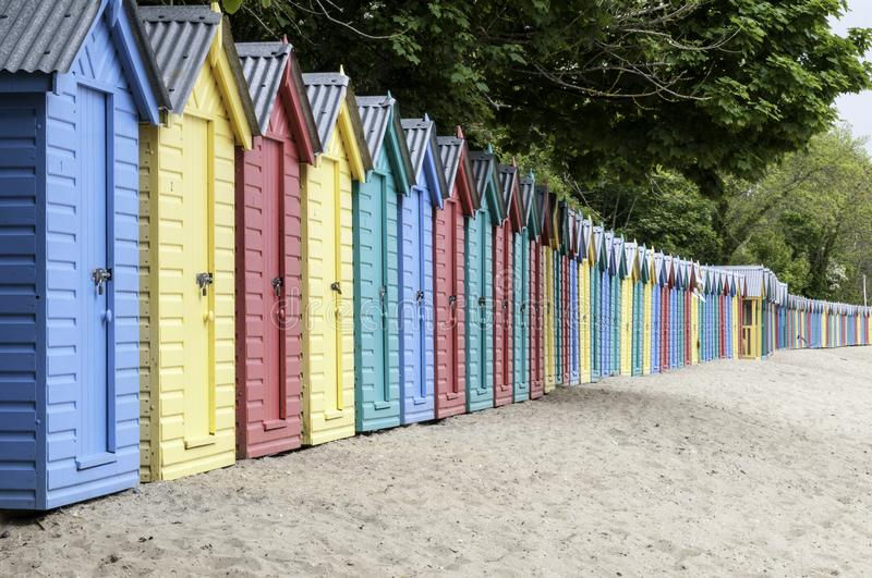 Vibrant Beach Huts on a Welsh beach stock photos