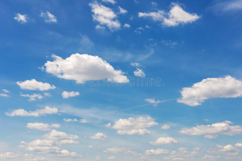 Vibrant blue sky with white clouds. Beautiful nature background stock images