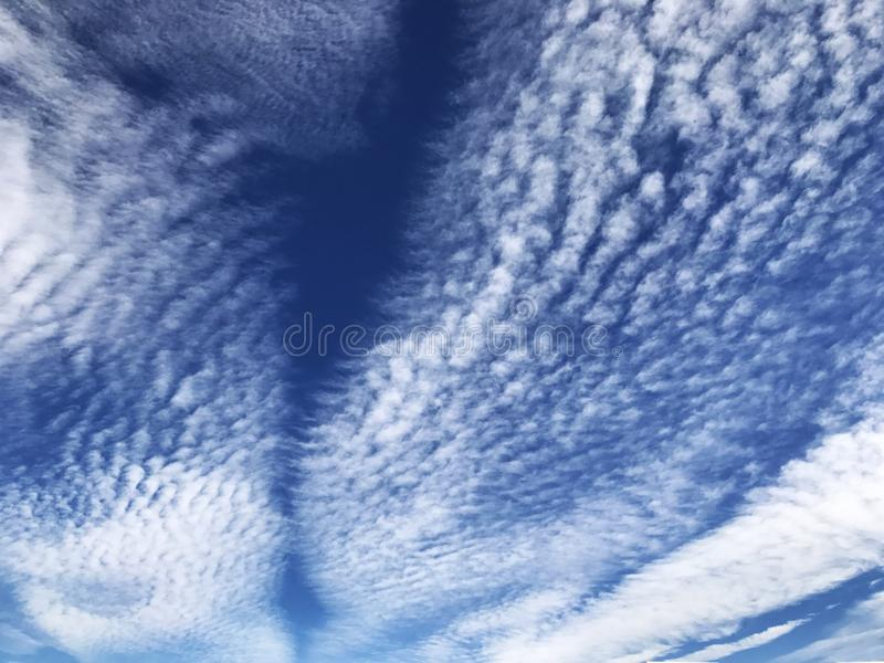Vibrant clouds sweeping through the sky royalty free stock image
