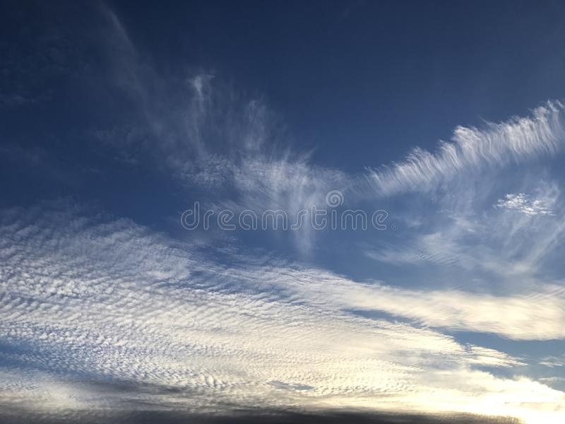 Vibrant clouds sweeping through the sky stock images