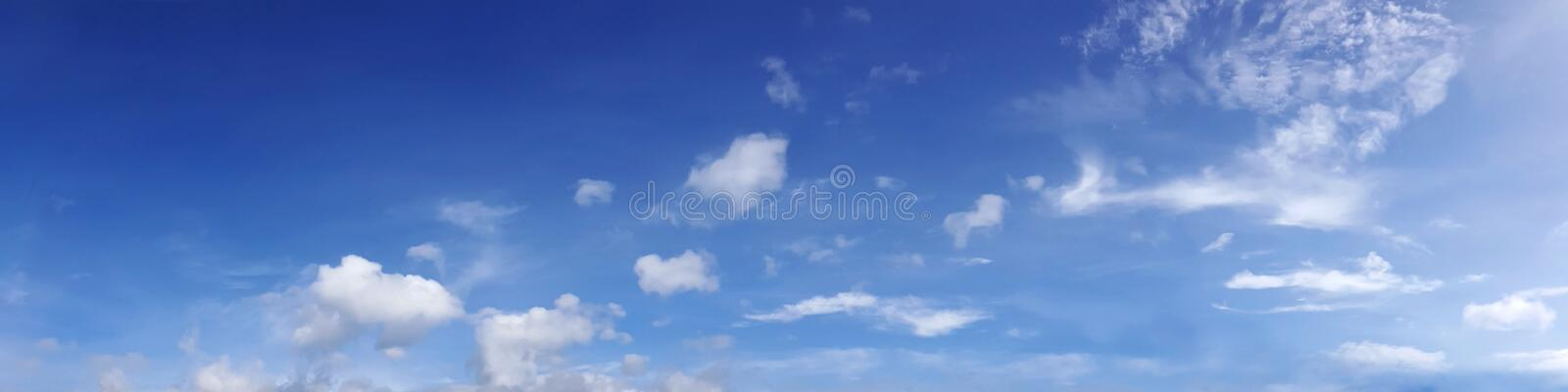 Vibrant color panoramic sky with cloud on a sunny day. Beautiful cirrus cloud. Panorama high resolution photograph royalty free stock images