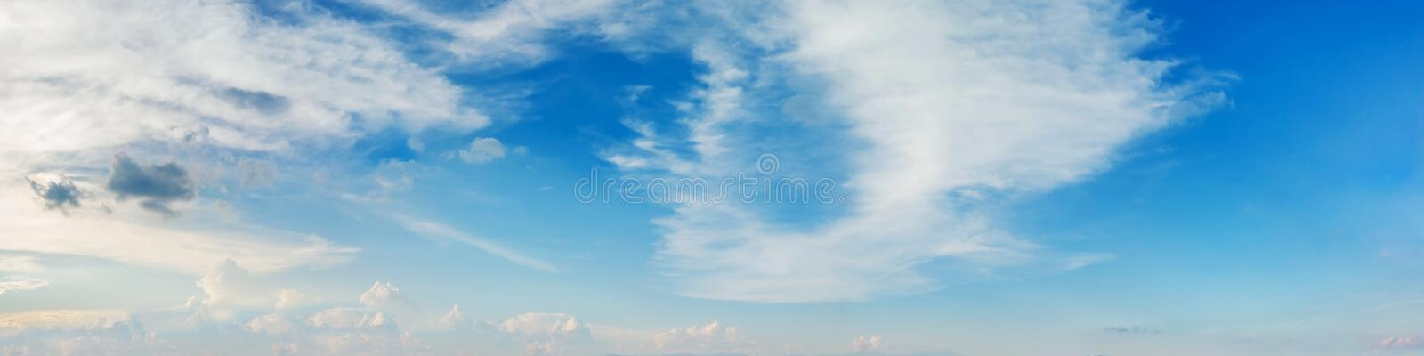 Vibrant color panoramic sky with cloud on a sunny day. Beautiful cirrus cloud. Panorama high resolution photograph stock image