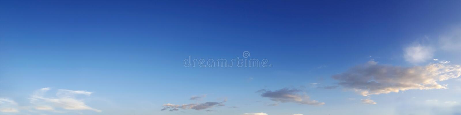 Vibrant color panoramic sky with cloud on a sunny day. Beautiful cirrus cloud. Panorama high resolution photograph royalty free stock photography