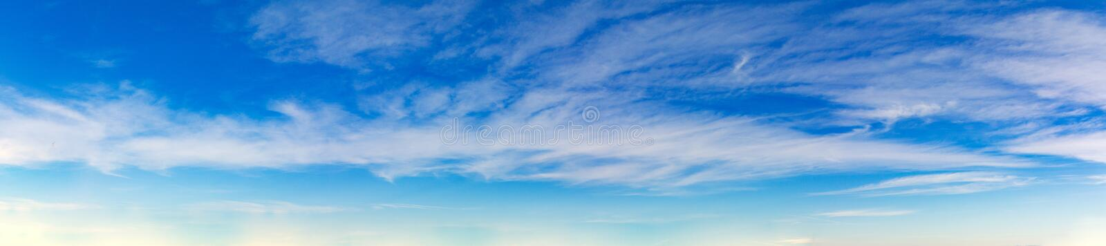 Vibrant color panoramic sky with cloud on a sunny day. Beautiful cirrus cloud. Panorama high resolution photograph royalty free stock photo