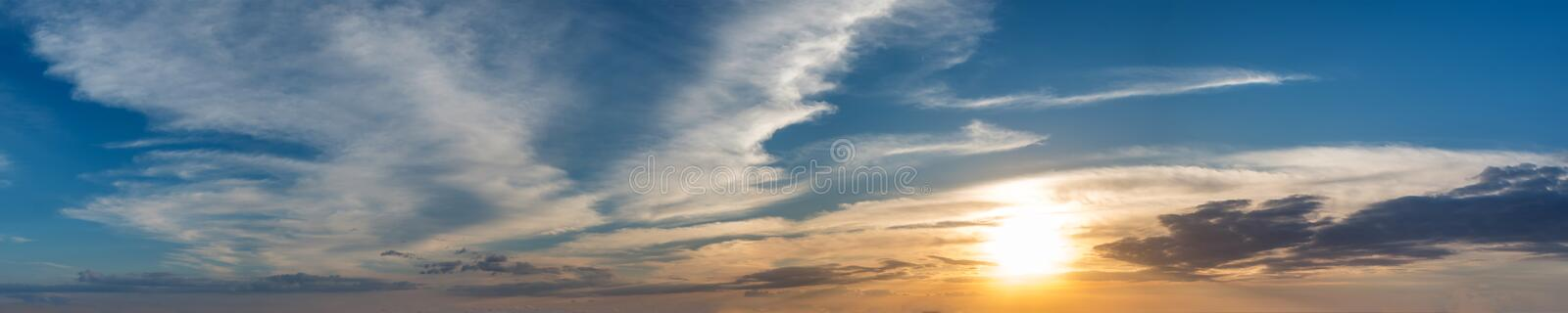 Vibrant color panoramic sun rise and sun set sky with cloud on a cloudy day. Beautiful cirrus cloud. Panorama high resolution photograph stock photo