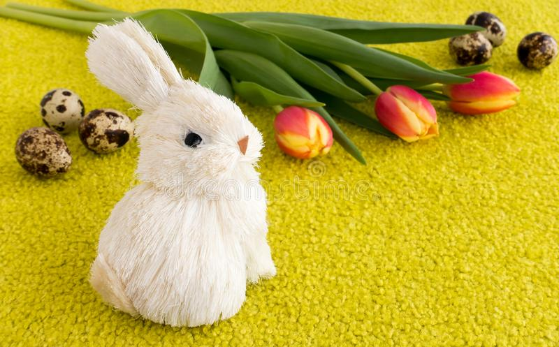 Easter Holiday with Easter Bunny, Tulips and Easter Eggs royalty free stock photography
