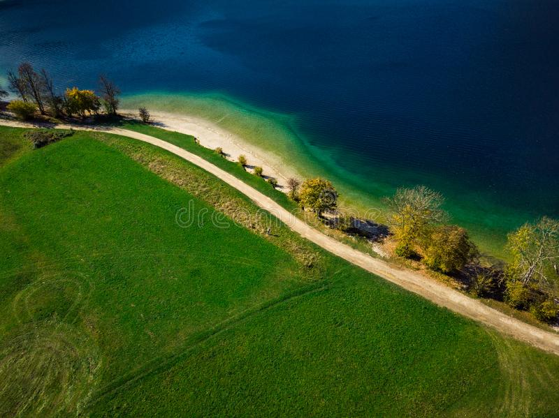 Vibrant colors of nature at Bohijn lake in Slovenia, drone view from above royalty free stock photography