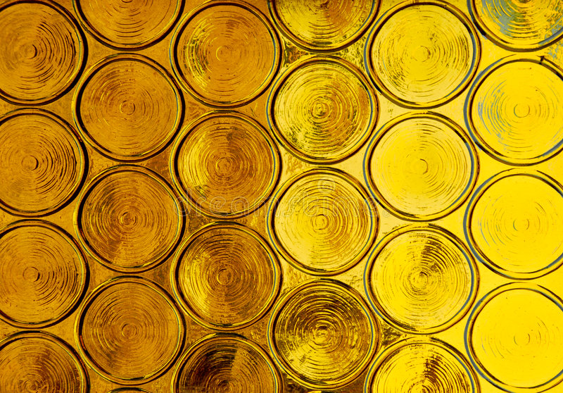 Vibrant Gold Circles from a Bright Window stock photos