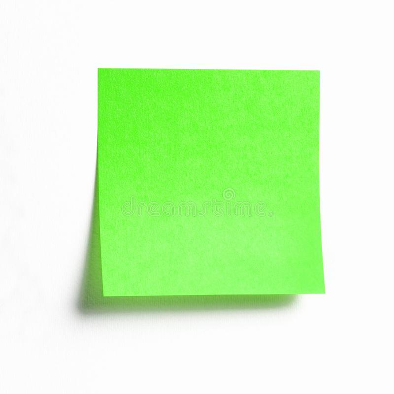 Vibrant green sticky note with shade isolated on white. Background, front view adhesive paper note with copy space royalty free stock image