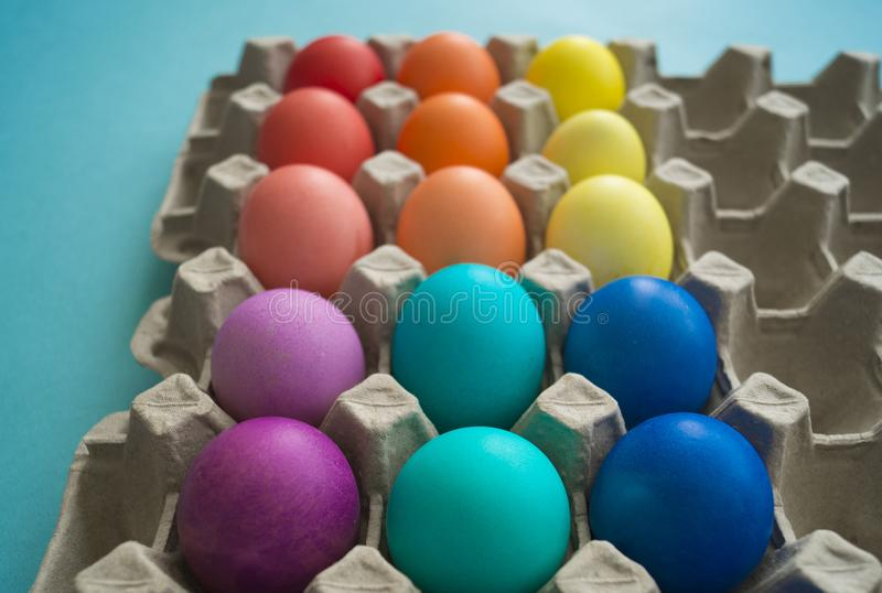 Vibrant hand dyed colorful Easter eggs in a cardboard egg box viewed royalty free stock images