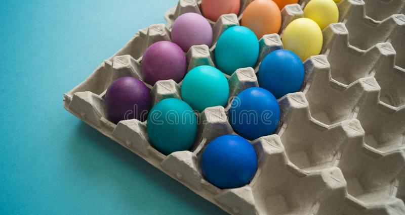Vibrant hand dyed colorful Easter eggs in a cardboard egg box viewed royalty free stock photos