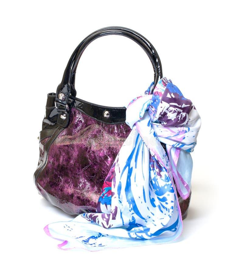 Vibrant Leather Ladies Handbag with Handkerchief. On white background stock photos
