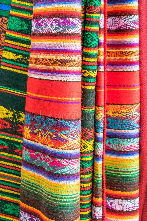 Hanging Colorful Mexican blankets with diverse patterns stock photos