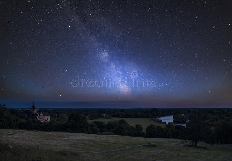 Vibrant Milky Way composite image over landscape of River Thames on Richmond Hill in London stock photos
