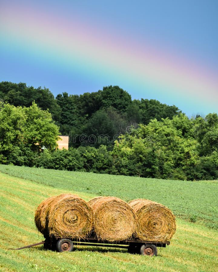 Free Vibrant Rainbow Over Three Rolled Haystacks Stock Images - 154540334