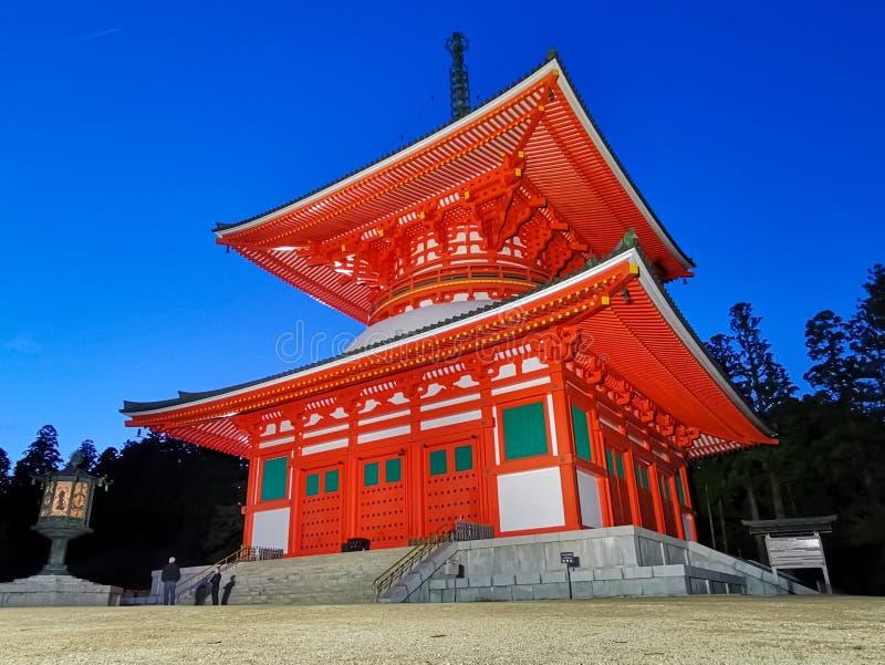 The vibrant red Konpon Daito Pagoda in the Unesco listed Danjo Garan shingon buddhism temple complex in Koyasan, Wakayama, Japan, royalty free stock photo