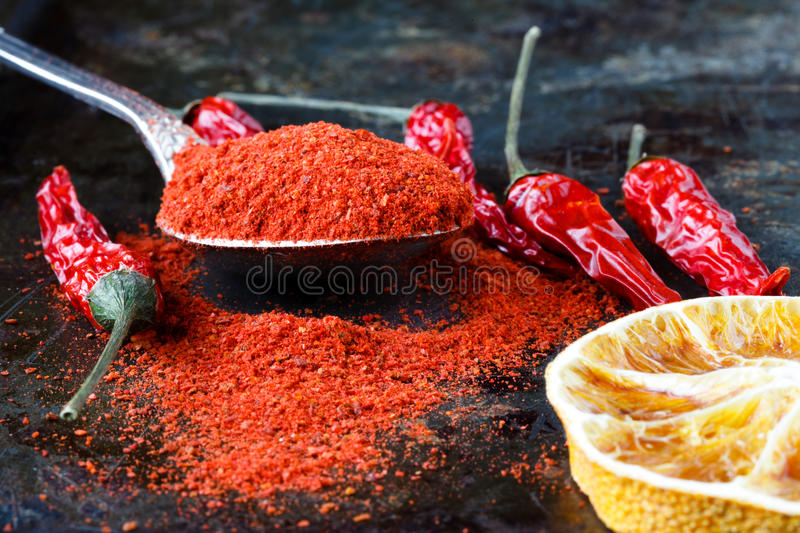 Vibrant red mexican hot chilli pepper, whole and grounded royalty free stock photography