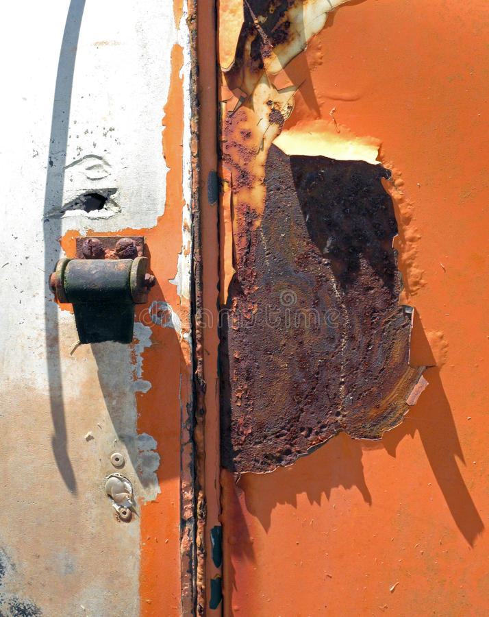 Vibrant Rust with a Shadow Accent. A vibrant sunlit piece of rusty metal with a shadow accent royalty free stock image