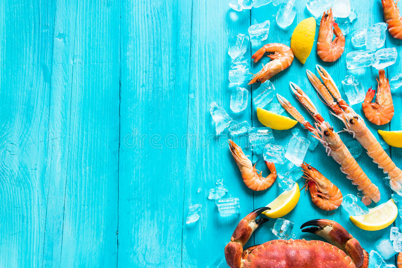Vibrant sea food background. Vibrant whole sea food background stock photos