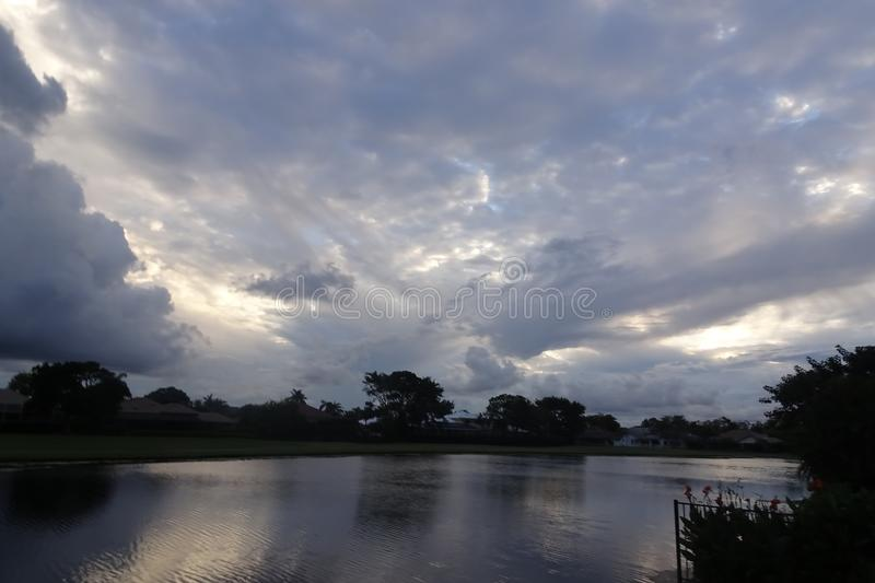 Stormy sunset over the lake in Florida royalty free stock images