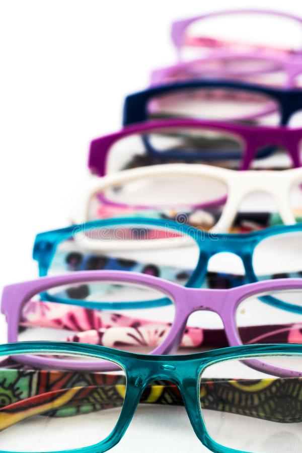 Multiple colored eye glasses smudged and lined on white background. Eye Health Concept royalty free stock photo