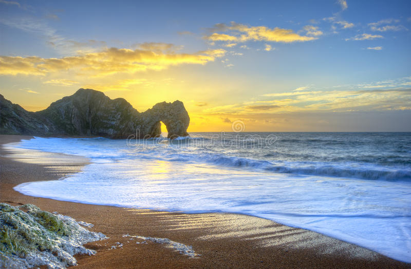 Download Vibrant Sunrise Over Ocean With Rock Stack In Foreground Stock Image - Image: 28708253