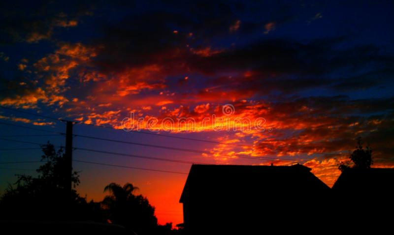 Vibrant sunset. Filling sky with oranges, blues, yellows, reds and purples stock photo
