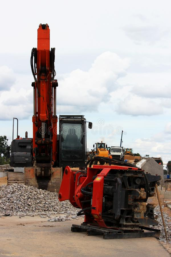 Vibrator pile driving Machine or vibro hammer stands on the site of construction of a major road junction. Russia. Vibrator pile driving Machine or vibro hammer stock photo