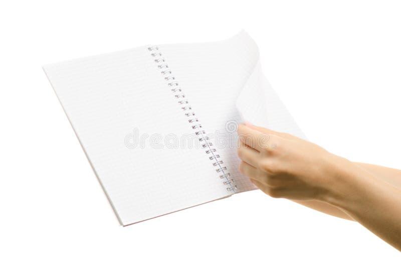 Vibrazione aperta della pagina del taccuino di bianco in mano femminile fotografia stock libera da diritti