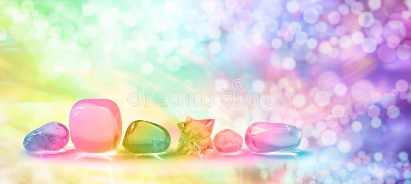 Vibrerande läka kristaller på det Bokeh banret royaltyfri bild