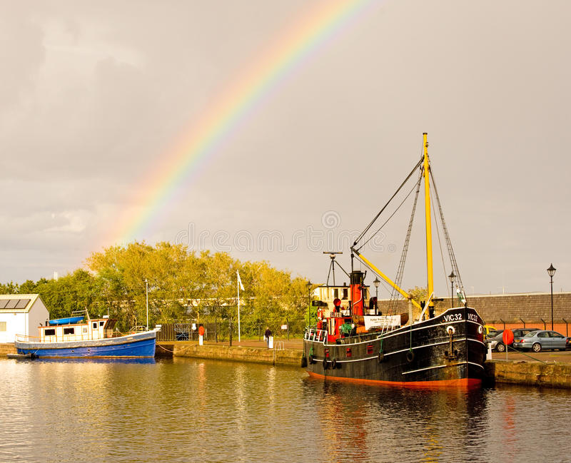 Download Vic 32 : boat and rainbow. editorial stock image. Image of yellow - 21078424