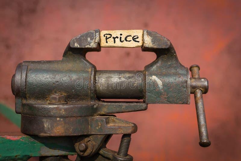 Vice herramienta Concepto de la reducción de precio imagen de archivo libre de regalías