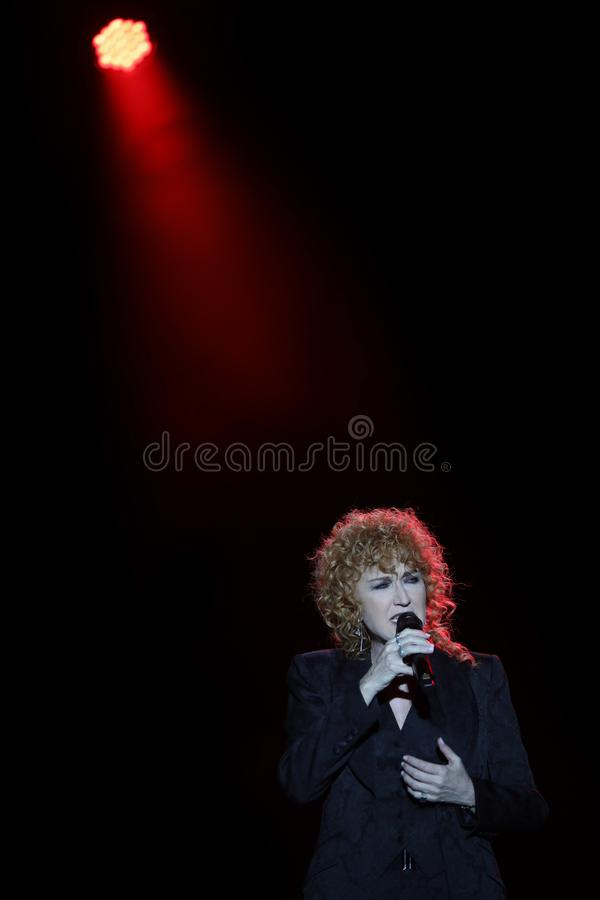 Vicenza, VI, Italy - September 5, 2019: FIORELLA MANNOIA a famou. S italian singer in live Concert with black background stock photography