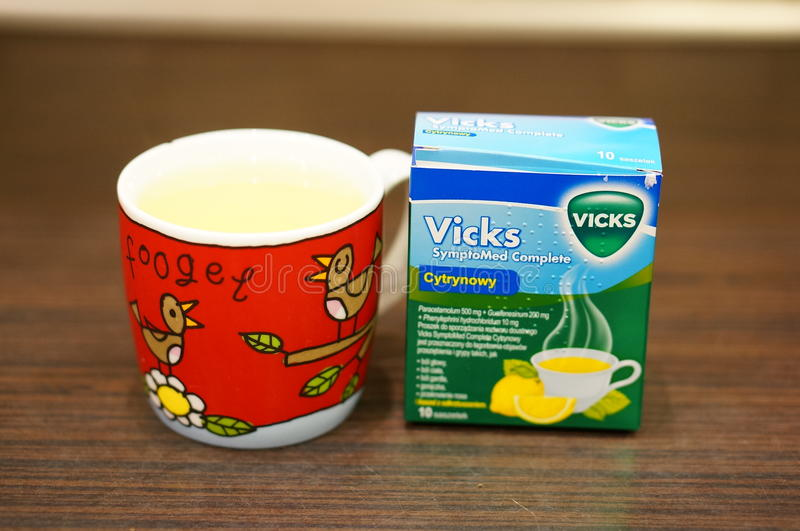 Vicks medicine. In cup against coughing stock photo