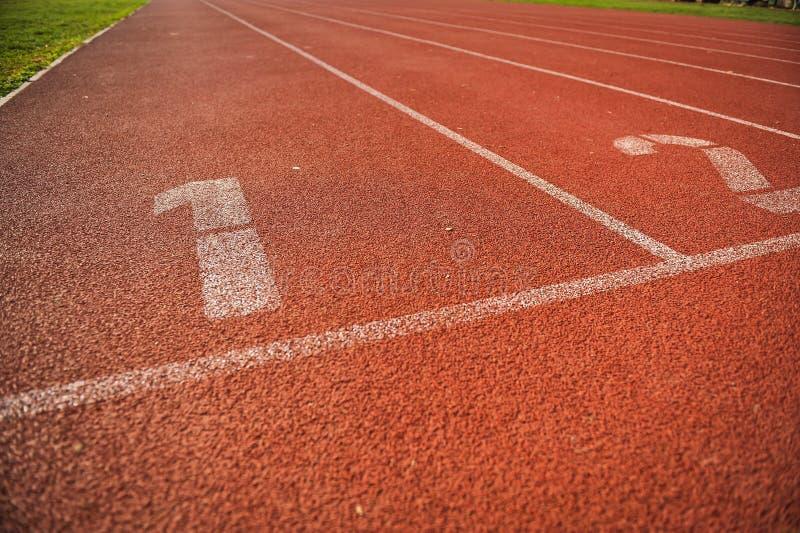 Vicoli della pista di atletica fotografia stock
