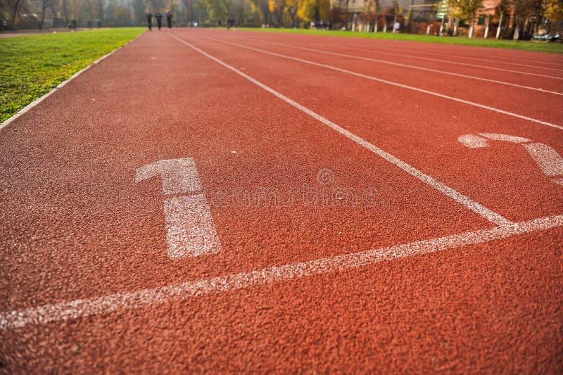 Vicoli della pista di atletica immagini stock