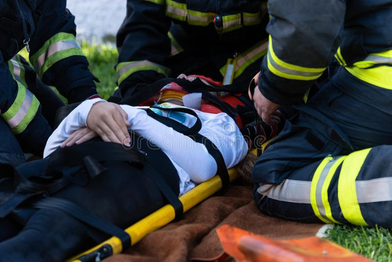 The victim in a car accident lies on a stretcher stock image