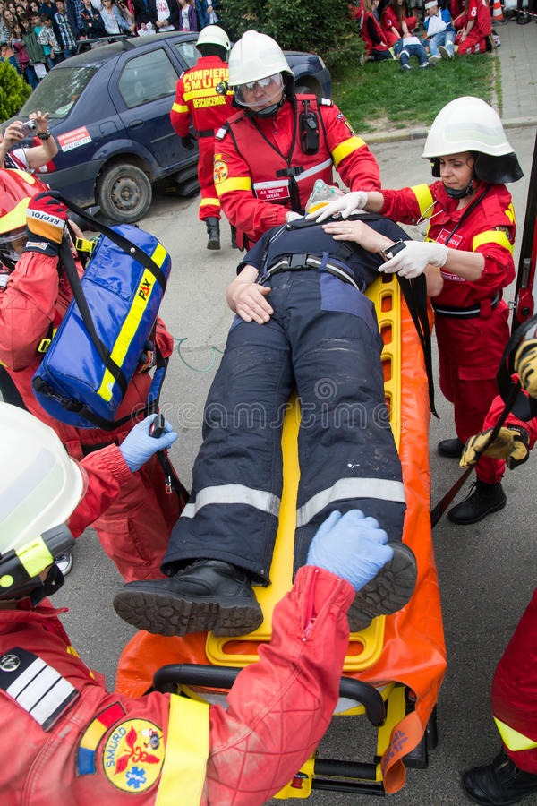 Rescuers of the Italian Red Cross carry the body of a